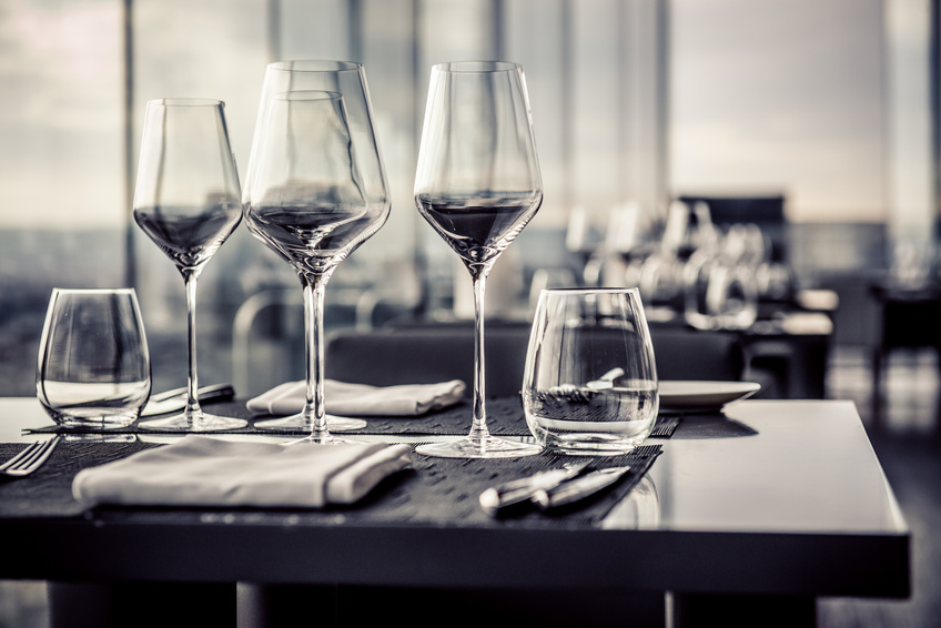 Empty glasses in restaurant, black and white photo